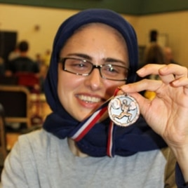 Kulsoom Abdullah sporting a medal she earned at a 2010 Open Championship in the US state of Georgia