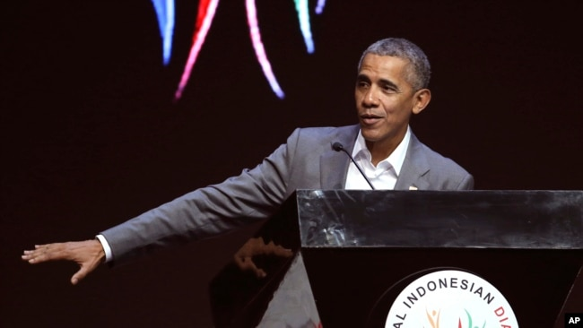 Former U.S. President Barack Obama gestures as he delivers his speech during the 4th Congress of the Indonesian Diaspora Network in Jakarta, Indonesia, Saturday, July 1, 2017.