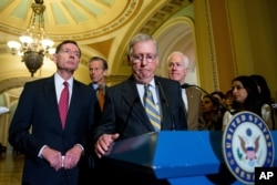 Senate Majority Leader Mitch McConnell of Ky., center, accompanied by, from left, Sen. John Barrasso, R-Wyo., Sen. John Thune, R-S.D., and Senate Majority Whip John Cornyn of Texas, pauses during a news conference on Capitol Hill, April 5, 2016.