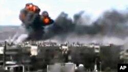 Một loạt các vụ nổ tàn phá trung tâm thành phố Homs, Syria, ngày 11/6/2012