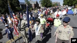 Boy Scouts line up before marching in the Utah Gay Pride Parade in Salt Lake City on Sunday, June 2, 2013.