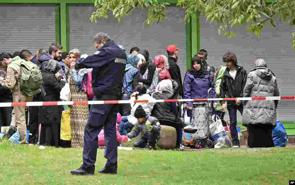 Migrants waiting for transport at a hall in Dortmund, Germany, Sept. 6, 2015. Thousands of migrants and refugees arrived in Dortmund by trains.