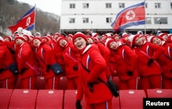 North Korean cheerleaders at a downhill skiing event at the Pyeongchang 2018 Winter Olympics, Feb. 14, 2018.