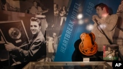 FILE - An 'Elvis' exhibit is seen inside an annex at Graceland in Memphis, Tennessee.