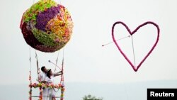 A couple in Thailand shoot an arrow through a heart on their wedding day. Unfortunately, many migrant brides in South Korea don't have such happy marriages.
