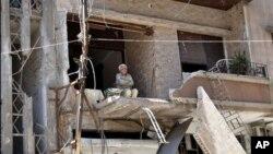 在敘利亞霍姆斯的建築遭到炮轟。