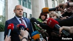 Ukrainian Energy Minister Yuri Prodan speaks with journalists as he arrives for talks with members of the Russian delegation and European Union Energy Commissioner Guenther Oettinger in Kyiv, June 14, 2014.
