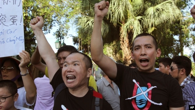 Vientnamese protesters chant anti-China slogans in Hanoi, Vietnam, June 19, 2014.