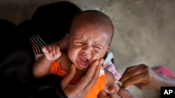 FILE - A Somali baby cries while receiving a five-in-one vaccine against several potentially fatal childhood diseases, at the Medina Maternal Child Health center in Mogadishu, Somalia
