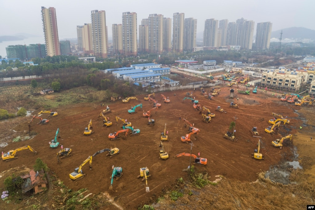 Excavators work at the building site of a new hospital being built in 10 days to treat patients from a virus outbreak in Wuhan in China's central Hubei province.
