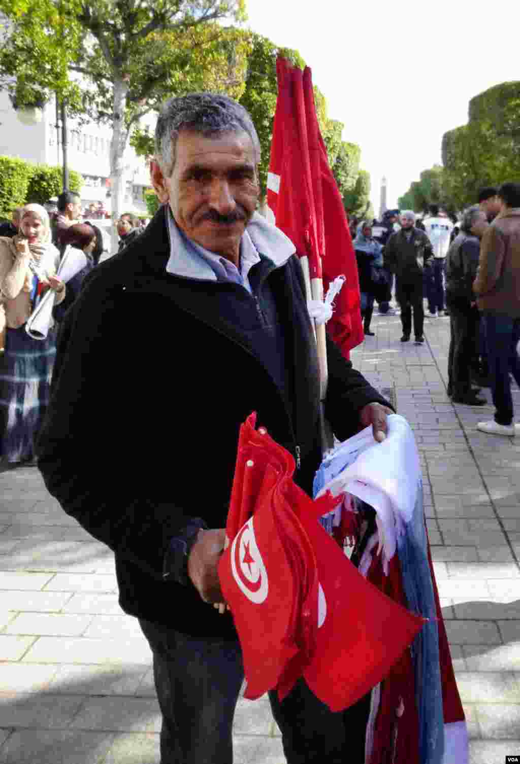 An Ennahda supporter selling flags in Tunis. (Henry Ridgewell for VOA)