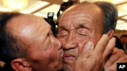 South Korean Yun Sang-in, left, kisses his North Korean elder brother Yun Tae Young on the last day of the three-day Separated Family Reunion Meetings at Diamond Mountain in North Korea, Nov. 1, 2010.