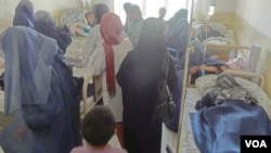 Relatives rush to hospital rooms where gassed students are treated, Takhar Province, Afghanistan, May 23, 2012. (Sayed Kabir Sayar/VOA Dari Radio)