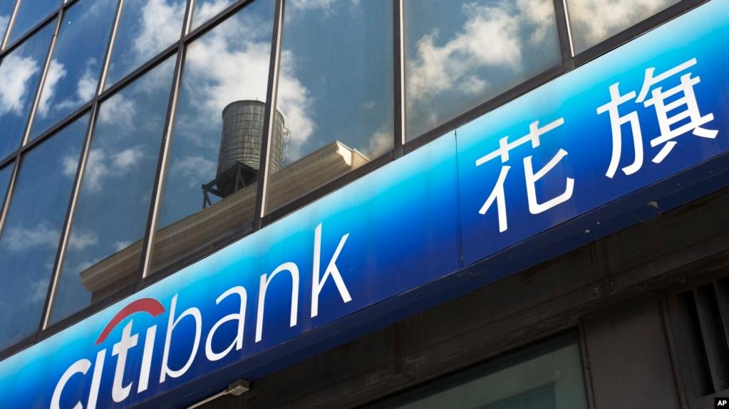 瑞银等多家银行限制员工赴中国出差(图)