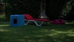 CN- Beach Mat Charges Cell Phone, Keeps Drinks Chilled
