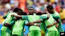 Les Super Eagles, le 30 juin 2014 au Stade National de Brasilia, Brésil lors d'un match de la coupe du monde. (AP Photo/Martin Meissner)