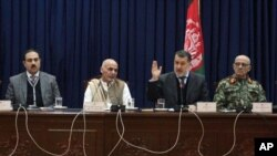 From left, Afghan security officials Mujtaba Patang, Ashraf Ghani Ahmadzai, Besmilah Mohammadi, and Lt. Gen. Sher Mohammad Karimi, address media, Kabul, Dec. 31, 2012.