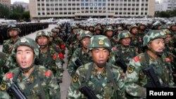 Armed paramilitary policemen stand in Urumqi, the capital of Xinjiang.
