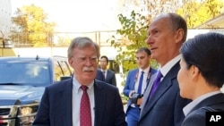 U.S. National Security Adviser John Bolton, left, and Russian Security Council chairman Nikolai Patrushev talk prior their official talks in Moscow, Russia, Oct. 22, 2018.