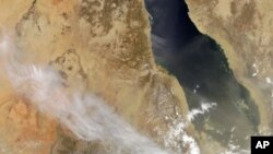 A natural-color image released by NASA shows plumes billowing from Nabro volcano in Eritrea on June 13, 2011