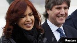 La presidenta argentina Cristina Fernández de Kirchner, junto a su vice presidente Amado Boudou. La presidenta anunció este lunes la expropiación de la petrolera YPF.