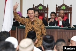 "FILE - Jakarta's Governor Basuki ""Ahok"" Tjahaja Purnama gestures inside the courtroom during his blasphemy trial in Jakarta, Indonesia, Jan. 3, 2017."