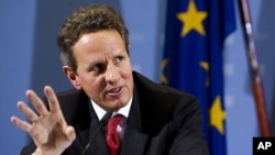 U.S. Treasury Secretary Timothy Geithner briefs the media during a news conference with German Finance Minister Wolfgang Schaeuble after a meeting at the finance ministry in Berlin, Tuesday, Dec. 6, 2011.