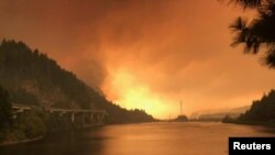 FILE - The Eagle Creek fire seen burning along the Columbia River in Oregon, Sept. 5, 2017.