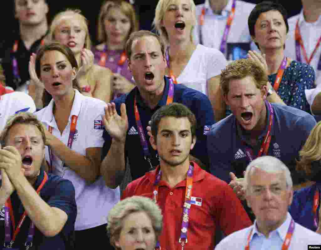 Britain's Prince William (C), his wife Catherine (L), Duchess of Cambridge and Prince Harry cheer for the British team as they watch the track cycling event at the Velodrome during the London 2012 Olympic Games August 2, 2012.