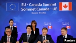 (L-R) European Commission President Jean-Claude Juncker, Canada's Prime Minister Justin Trudeau, European Council President Donald Tusk and Slovakia's Prime Minister Robert Fico attend the signing ceremony of the Comprehensive Economic and Trade Agreement