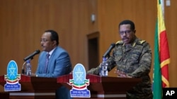 Lt. Gen. Bacha Debele of the Ethiopian National Defense Force, right, gives a press conference with Redwan Hussein, spokesperson for the Tigray task force, about the situation in the country's Tigray region, in Addis Ababa, Ethiopia, June 30, 2021.