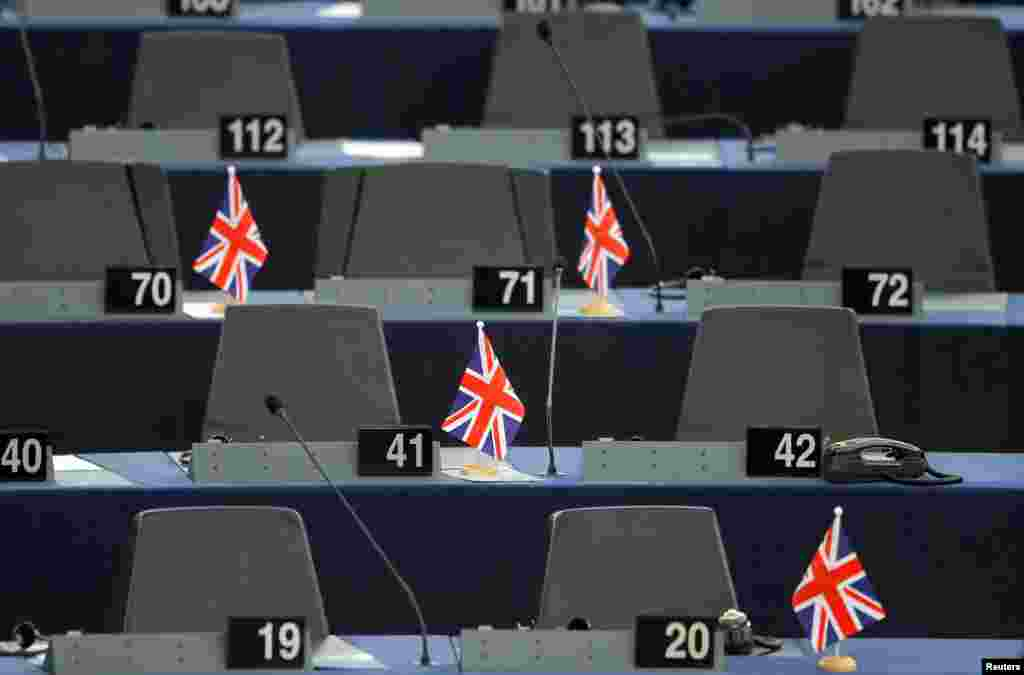 British Union Jack flags are seen on the desks, ahead of a debate on the future of Europe, at the European Parliament in Strasbourg, France.