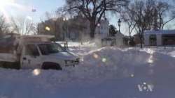 US Communities Clean Up After Massive Snowstorm