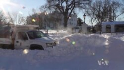 US Communities Clean Up After Massive Snowstorm