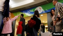 FILE - Passengers line up during a security check ahead of the 2016 Rio Olympics at Congonhas Airport in Sao Paulo, Brazil, July 18, 2016.