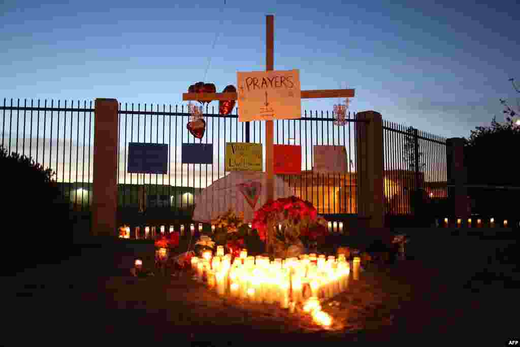 A memorial is seen near the Inland Regional Center as the community remembers those injured and killed during a mass shooting Wednesday at the center in San Bernardino, California.