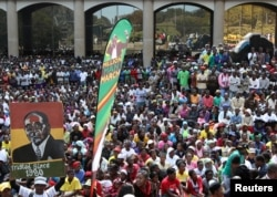 Thousands of supporters of the ruling party Zanu PF gather outside the party headquarters to show support for President Robert Mugabe following a wave of anti-governement protests over the last two weeks in Harare, Zimbabwe on July 20, 2016