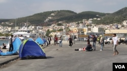 At the port in Lesvos, Greece, many refugees from Afghanistan, Iraq and Syria who cannot afford the 48 euros for a boat to their next destination wait in tents, many hoping to find another way, Sept. 12, 2015. (Credit: Heather Murdock/VOA)