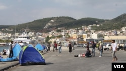 At the port in Lesbos, Greece, many refugees from Afghanistan, Iraq and Syria arrive seeking to go to other places in Europe. (Credit: Heather Murdock/VOA)