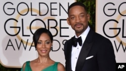 Jada Pinkett Smith, left, and Will Smith arrive at the 73rd annual Golden Globe Awards, Jan. 10, 2016.