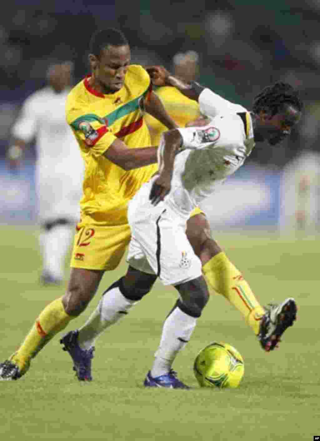 Ghana's Annan Anthony (R) challenges Kaita Seydou of Mali during their African Cup of Nations Group D soccer match in FranceVille Stadium January 28, 2012.