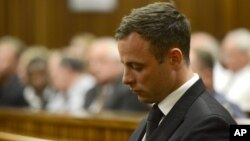 FILE - Oscar Pistorius sits in court, after judge Thokozile Masipais sentenced him to five years in prison, in Pretoria, South Africa, Oct. 21, 2014.
