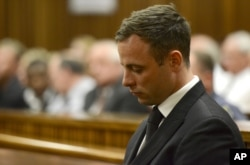 FILE - Oscar Pistorius sits in court, after being sentenced to five years in prison, Oct. 21, 2014.