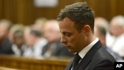 Oscar Pistorius sits in court, after judge Thokozile Masipais sentence Pistorius to five years in prison, in Pretoria, South Africa, Oct. 21, 2014.