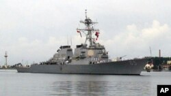 In this Aug. 8, 2016, file photo, the guided missile destroyer USS Benfold arrives for a visit at port in Qingdao, China. (AP Photo/Borg Wong, File)