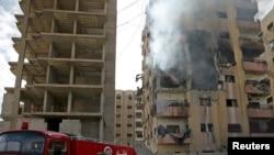 Hiện trường sau các cuộc không kích của quân đội ủng hộ chính phủ Syria ở khu phố Douma, Damascus, Syria, ngày 14/2/2016.