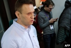 FILE - Russian opposition leader Alexei Navalny is seen at his office in Moscow, March 18, 2018.