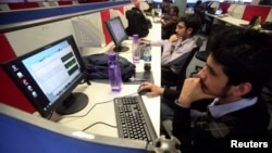 FILE: Employees of Snapdeal.com, an Indian online discount shopping website, work inside their company office in New Delhi, Mar. 1, 2012.