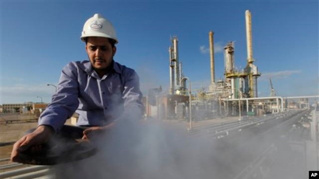 In this February 2011 photo, a man works at an oil refinery in eastern Libya, where support for federalism is growing.