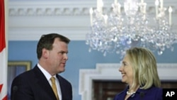 Secretary of State Hillary Rodham Clinton (r) with Canadian Foreign Minister John Baird at the State Department in Washington, Aug. 4, 2011